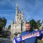Cameron Tysor in front of the Disney Castle