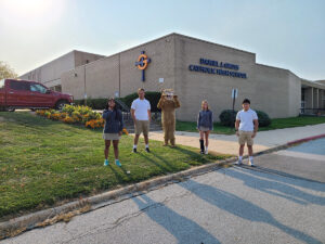 Students in front of Gross Catholic's Campus building